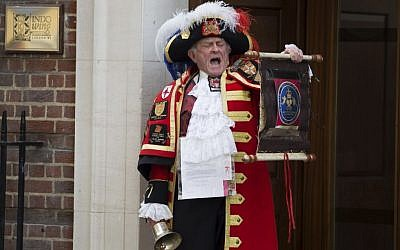 Tony Appleton, a town crier, announces the birth of the royal baby outside the Lindo Wing, St. Mary's Hospital, London, Saturday, May 2, 2015. Kate, the Duchess of Cambridge, has given birth to a baby girl, royal officials said Saturday. (photo credit: Daniel Leal-Olivas/PA via AP)