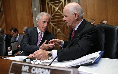 Senate Foreign Relations Committee Chairman Sen. Bob Corker (R-Tennessee), left, shakes hands with ranking member Sen. Ben Cardin (D-Maryland) during a committee markup meeting on the proposed nuclear agreement with Iran on April 14, 2015. (JTA/Win McNamee/Getty Images)