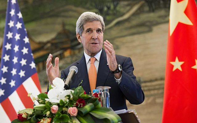 US Secretary of State John Kerry speaks during a joint press conference with Chinese Foreign Minister Wang Yi following their meetings at the Ministry of Foreign Affairs in Beijing Saturday, May 16, 2015. Kerry was in China to press Beijing to halt increasingly assertive actions it is taking in the South China Sea that have alarmed the United States and China's smaller neighbors. (Saul Loeb/Pool Photo via AP)
