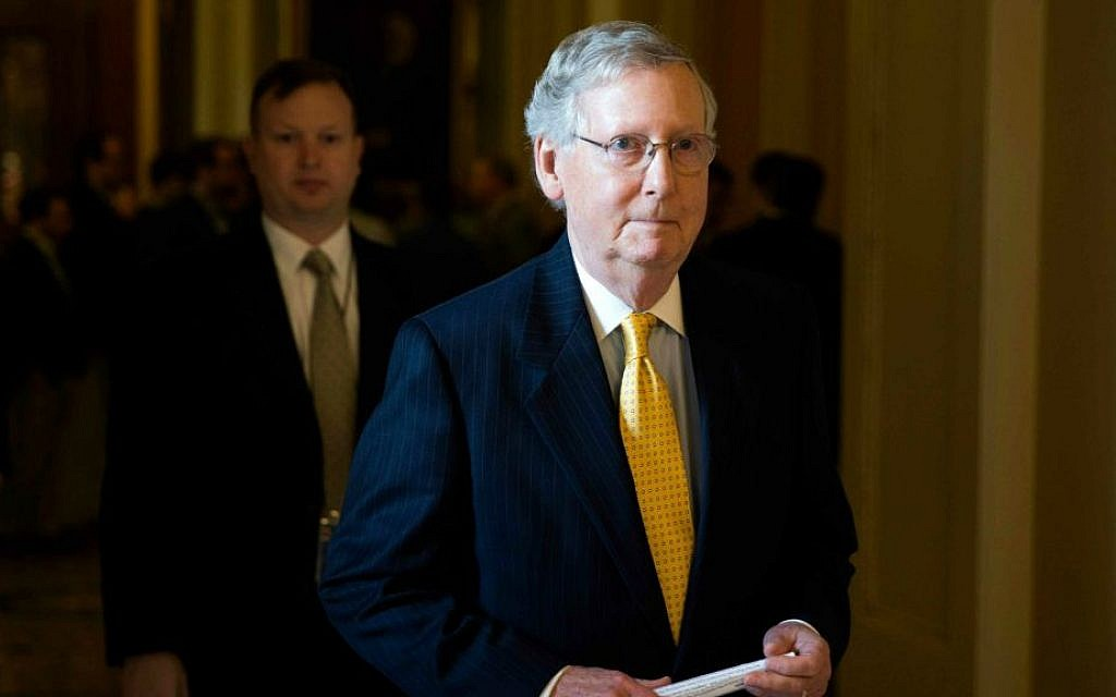 In this May 5, 2015, file photo, Senate Majority Leader Senator Mitch McConnell of Kentucky walks to his office on Capitol Hill in Washington, after a news conference. (Evan Vucci/AP)