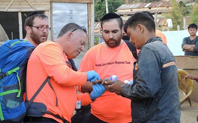 Israeli paramedics treated six villagers during a one hour temporary clinic in a village three hours from Kathmandu. Everyone wanted to help, but sometimes the lack of communication and local knowledge made aid work less effective. (photo credit: Melanie Lidman/Times of Israel)