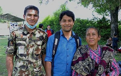 Pushkar Bishwokarma (center), outside the Nepali field hospital where he tried to volunteer. He is with his cousin Deness Bishwokarma (left), who is stationed at the hospital, and his mother, Sarada Bishwokarma. May 2015. (photo credit: Melanie Lidman/Times of Israel)