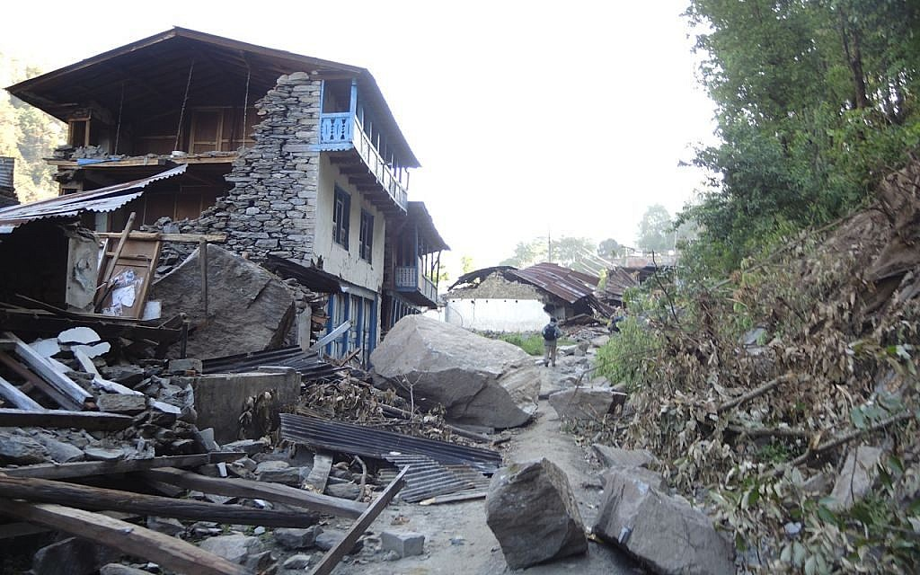 Enormous boulders that crashed down in a rockslide demolished homes in the village of Topani, in the hard-hit Sidhulpalchowk district, seven hours away from Kathmandu, May 2015. (photo credit: Melanie Lidman / Times of Israel)