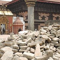 The rubble of a temple called Vatsala Durga in the old city of Bhaktapur near Kathmandu after the first earthquake. The 16th Century Vatsala Durga temple was famous for its sandstone walls and gold-topped pagodas. A few of the buildings in the square did survive the earthquake. (Melanie Lidman/Times of Israel)