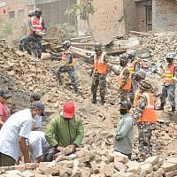 Nepali army soldiers and employees from the local tourism department clear the rubble in Durbar Square in Bakhtapur. Two weeks after the first earthquake, the square looked much cleaner than other damaged areas due to the vigilant work of residents, volunteers, and officials to clean the heritage site. (Melanie Lidman/Times of Israel)