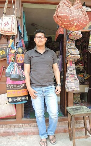 Sanjay Darshandhari, 20, the owner of a handicraft store in Bhaktapur, said he opened his store soon after the quake to help normalcy return to the neighborhood. (Melanie Lidman/Times of Israel)