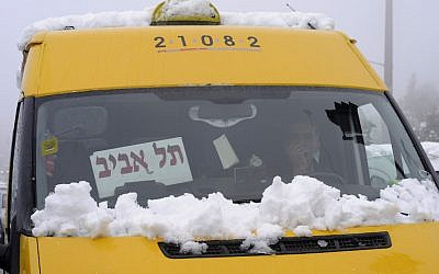 A shared sherut taxi on the way to Tel Aviv, January 10, 2013. (Photo credit: Louis Fisher/Flash90)