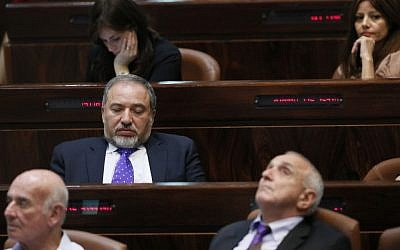 An illustrative photo of bored looking lawmakers in the Knesset on October 14, 2013. (Photo credit: Miriam Alster/FLASH90)