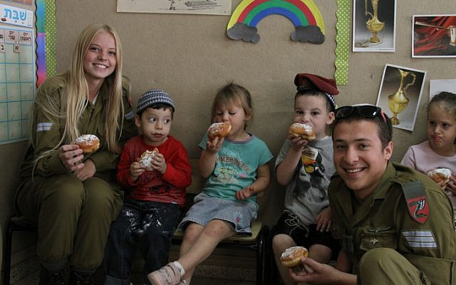 Soldiers considering conversion during a November 7, 2013 visit to a Kindergarten in Efrat on Hannukah (Gershon Elinson/ Flash 90)