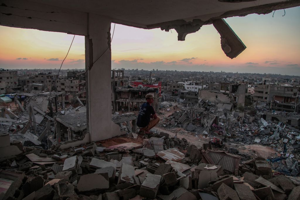 A man sits in a destroyed house in Al Shejaeiya neighborhood in the east of Gaza City, August 28, 2014 (photo credit: Emad Nassar/Flash90)