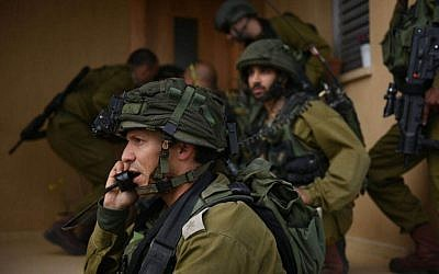 Illustrative: Soldiers practice in an IDF drill in the Gaza Border Division on March 22, 2015. (IDF Spokesman)