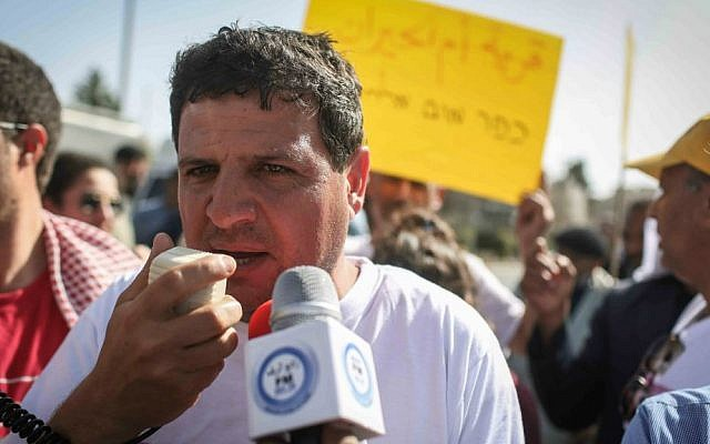 Arab Joint List leader Ayman Odeh speaks with the press in front of the President's Residence during a demonstration of Bedouin activists in Jerusalem, March 29, 2015. (Hadas Parush/Flash90)