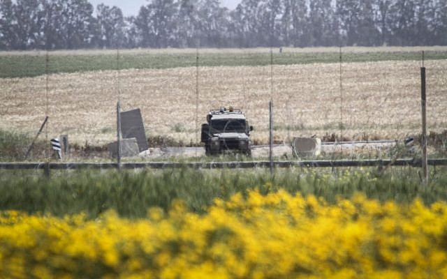 An IDF vehicle in Absan, near the border between Israel and east of the town of Khan Yunis in the southern Gaza Strip, March 30, 2015 (Abed Rahim Khatib/Flash90)
