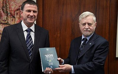 State Comptroller Yosef Shapira (R) hands the State Comptroller's report to chairman of the Israeli parliament Yuli Edelstein in the Knesset on May 05, 2015. (Photo credit: Isaac Harari/ Flash90)