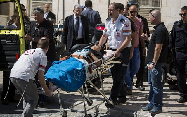 Israeli attorney Ruth David, connected to the court case on Israeli attorney Ronel Fisher is taken by paramedics into an ambulance outside the Magistrate's court in Jerusalem on May 08, 2015. (Photo credit: Yonatan Sindel/Flash90)