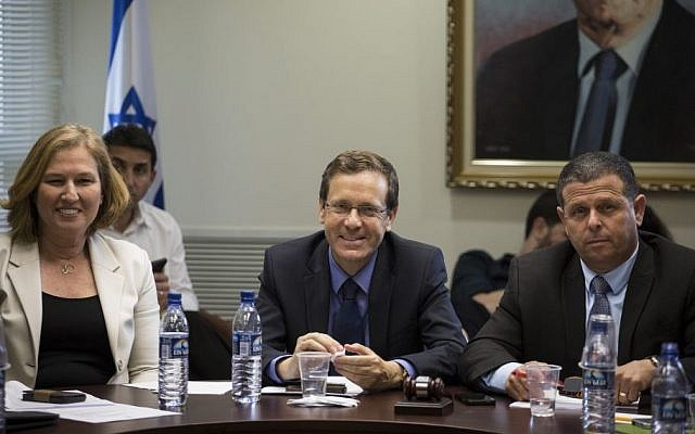 MK Tzipi Livni (L) MK Isaac Herzog (C) and MK Eitan Cabel (R) of the Zionist Camp party seen during a party meeting at the Knesset, Jerusalem, May 11, 2015. (photo credit: Hadas Parush/Flash90)