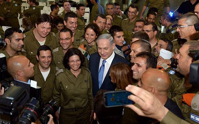 Prime Minister Benjamin Netanyahu (C) seen during a welcome ceremony for the IDF aid delegation that arrived back from Nepal at Ben Gurion Airport, May 12, 2015. (photo credit: Haim Zach/GPO)