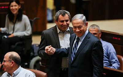 Prime Minister Benjamin Netanyahu shakes hands with Likud MK Zeev Elkin during a plenum session and vote on expanding the number of ministers in the new government, in the Knesset on May 13, 2015. (photo credit: Hadas Parush/Flash90)
