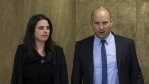 Justice Minister Ayelet Shaked (L) and Education Minister Naftali Bennet arrive at the first cabinet meeting of the Israel's 34th government at the Prime Minister's Office in Jerusalem on May 15, 2015. (Yonatan Sindel/Flash90)