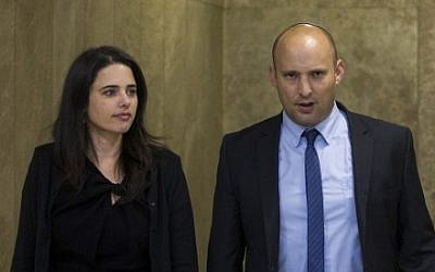 Justice Minister Ayelet Shaked, left, and Education Minister Naftali Bennett arrive at the first cabinet meeting of the Israel's 34th government at the Prime Minister's Office in Jerusalem on May 15, 2015. (Yonatan Sindel/Flash90)