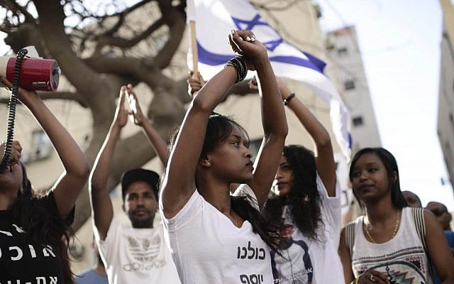 Illustrative: Ethiopian Israelis protest in Tel Aviv against violence and racism directed at Israelis of Ethiopian descent, May 18, 2015. (Tomer Neuberg/Flash90)