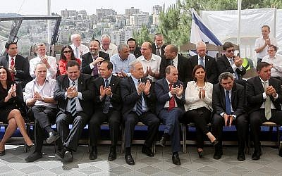 Cabinet members pose for a group picture during a special cabinet meeting at the Israel Museum in Jerusalem, together with Jerusalem mayor Nir Barkat, on May 19, 2015. (Marc Israel Sellem/Flash90)