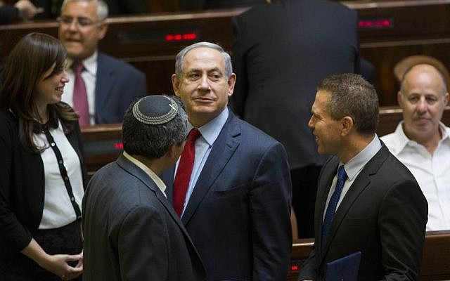 Newly appointed Minister of Internal Security, Gilad Erdan (R) speaks with Prime Minister Benjamin Netanyahu (C) and Minister of Immigrant Absorption Ze'ev Elkin at the Knesset assembly hall, May 25, 2015. (Yonatan Sindel/Flash90)