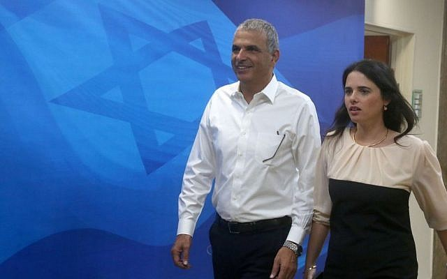 Finance Minister Moshe Kahlon (left), and Justice Minister Ayelet Shaked (right) arrive for the weekly cabinet meeting at the Prime Minister's Office in Jerusalem, May 26, 2015. (Marc Israel Sellem/Pool/Flash90)