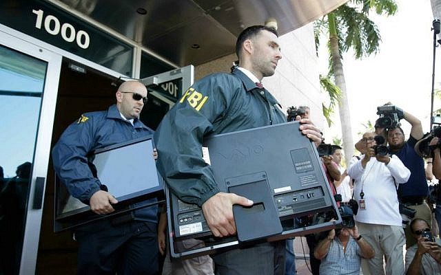 Federal agents load a van with boxes and computers taken from the headquarters of the Confederation of North, Central America and Caribbean Association Football (CONCACAF,) Wednesday, May 27, 2015, in Miami Beach, Florida. (AP Photo/Wilfredo Lee)