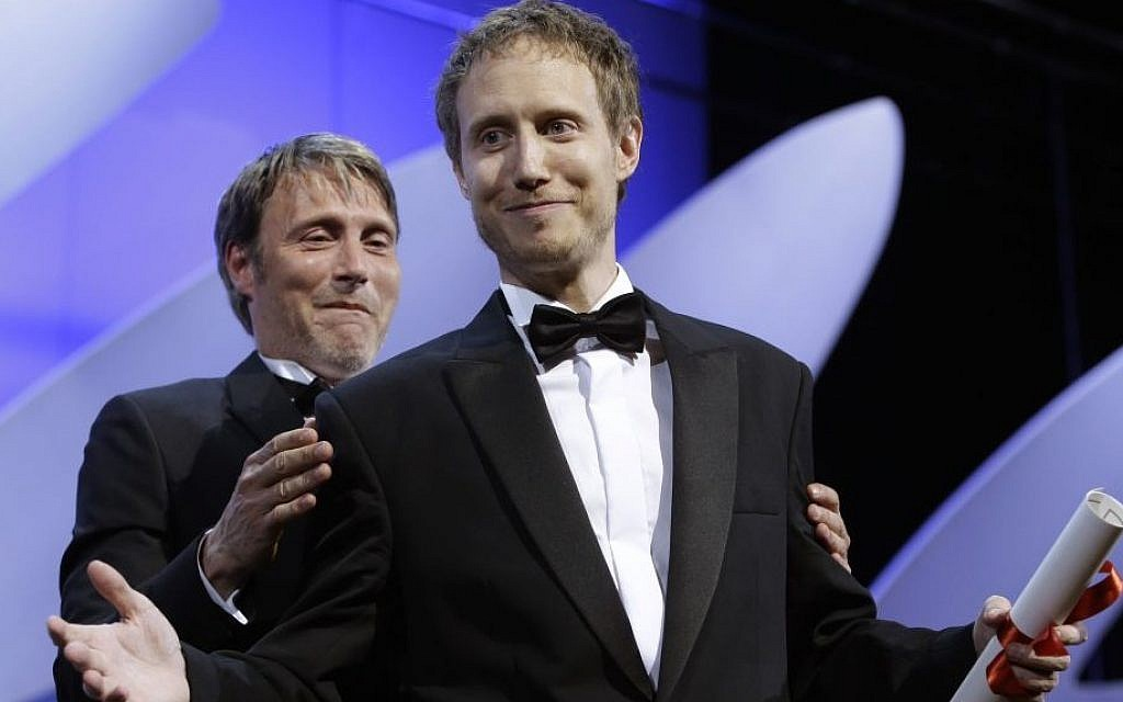 Director Laszlo Nemes, right, is presented the Grand Prix award by actor Mads Mikkelsen for the film Son of Saul during the awards ceremony at the 68th international film festival, Cannes, southern France, Sunday, May 24, 2015. (AP Photo/Lionel Cironneau)