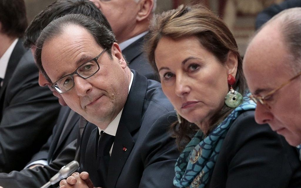 French President Francois Hollande, left, French Ecology Minister Segolene Royal and French Interior Minister Bernard Cazeneuve, right, attend a plenary meeting of a French-Italian summit entitled 'Economy, Investment and Finance,' during a French-Italian summit at the Elysee Palace in Paris, Tuesday, Feb. 24, 2015 (Jacques Demarthon/Pool Photo via AP, FILE)