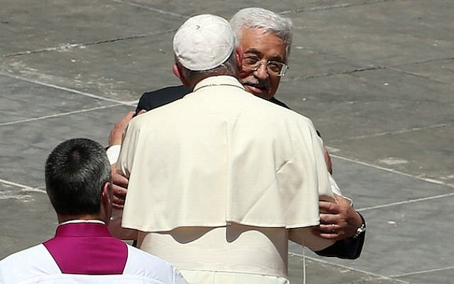 Pope Francis greeting Palestinian Authority President Mahmoud Abbas as the pope leaves St. Peter's Square at the end of a canonization ceremony in Vatican City, May 17, 2015. (Franco Origlia/Getty Images/JTA)
