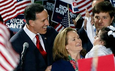 Former US Senator Rick Santorum, left, and his wife Karen, center, talk with his daughter Bella, right, as he announces his candidacy for the Republican nomination for President of the United States in the 2016 election on Wednesday, May 27, 2015 in Cabot, Pennsylvania. (AP Photo/Keith Srakocic)