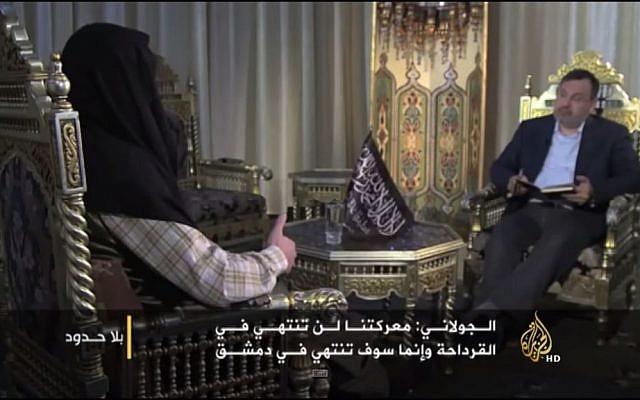 Al-Nusra Front leader Abu-Mohammed al-Golani speaks to al-JAzeera, May 27, 2015 (Youtube screen capture)