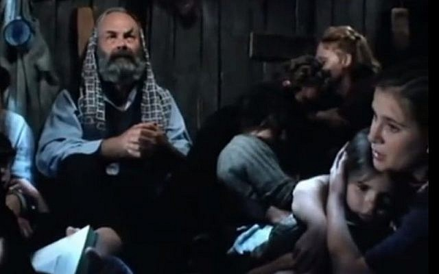 Image from the 1996 film 'Hidden in Silence,' based on the true life events of the 13-member Diamant family who were hid in the attic of two Polish orphans during the Holocaust (screen capture: YouTube)