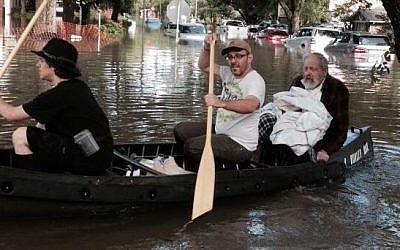 Houston Rabbi Joseph Radinsky is paddled to safety, May 27, 2015 (Facebook)