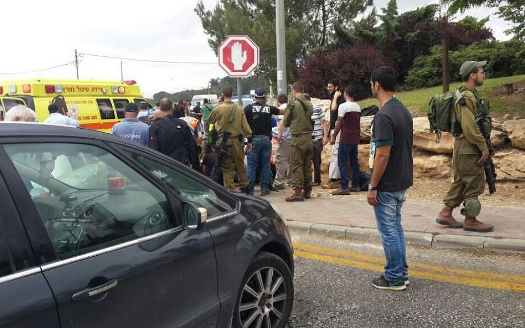Paramedics attend to three teenagers who were hurt in a suspected car-ramming attack in Alon Shvut in the West Bank, May 14, 2015. Courtesy Zaka