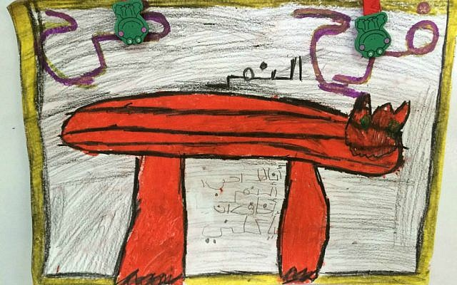 """Drawing by child at El-Ma'ley Kindergarten in Baqa al-Gharbiyye depicting his fear of panthers—a response to """"Supposing,"""" a Maktabat al-Fanoos (Lantern Library) book. (photo credit: Renee Ghert-Zand/Times of Israel staff)"""