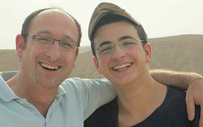 Ofir Shaer (left) with his son Gil-ad Shaer, who, together with Naftali Frenkel and Eyal Yifrah, was kidnapped and murdered by Palestinian terrorists in June 2014. (Courtesy)