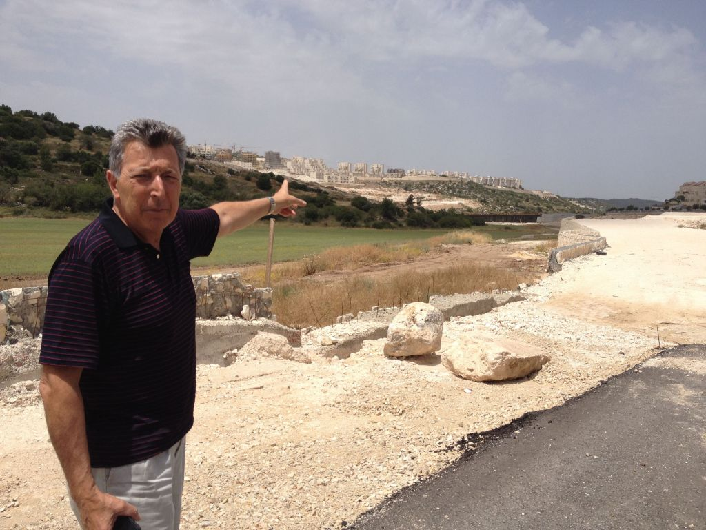 Beit Shemesh resident Motti Malka on his weekly tour to check out ongoing construction in his city (photo credit: Jessica Steinberg/Times of Israel)