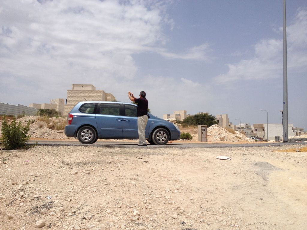 Malka and his mini-van; a man on a mission (Photo credit: Jessica Steinberg/Times of Israel)