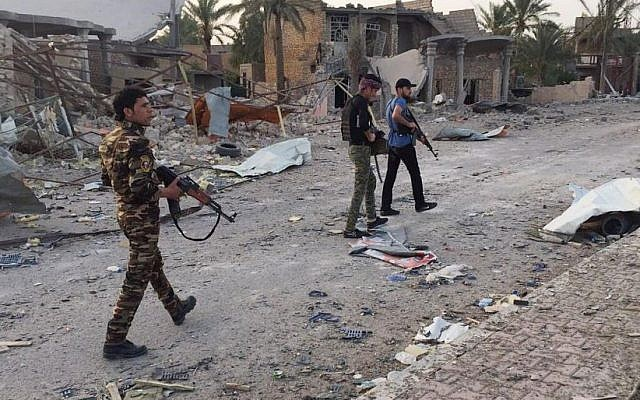 In this April 23, 2015 file photo, Iraqi security forces and tribal fighters regain control of the northern neighborhoods, after overnight heavy clashes with Islamic State group militants, in Ramadi, 70 miles (115 kilometers) west of Baghdad, Iraq. (AP Photo, File)