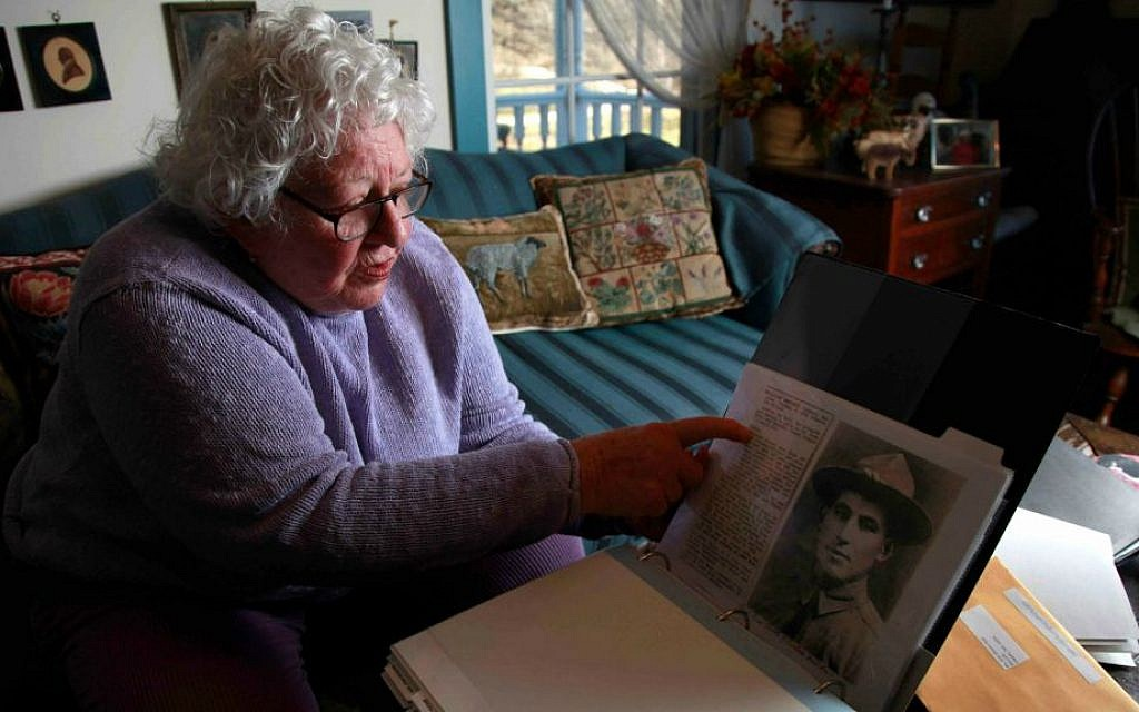 In this Jan. 5, 2012 file photo, Elsie Shemin-Roth flips through a book documenting the heroic acts of her father, William Shemin, during World War I, at her home in Labadie, Mo. (AP Photo/Jeff Roberson, File)