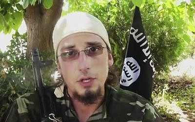 An undated image made from a video released by Islamic State militants appears to show Andre Poulin, a Canadian enlistee in the Islamic State group, speaking in a video that has been used for online recruitment (Militant video via AP)