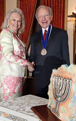 Ingeborg Rennert bestowing the Guardian of Zion Award and Medal on Sen. Joe Lieberman. (Yoni Reif/JTA)