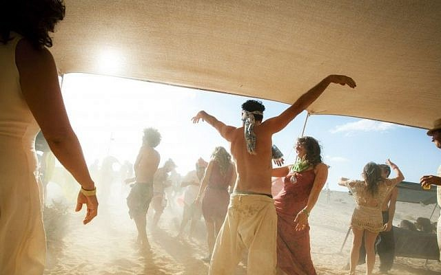 Partygoers dance during the second annual 'Midburn' festival, the Israeli version of 'Burning Man' on May 24, 2015. (Photo credit: Ben Kelmer/Flash90)