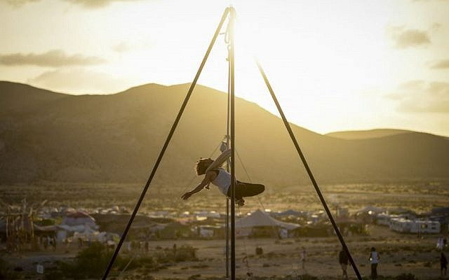 An artist performs at sunset during the second annual Midburn festival, the Israeli version of Burning Man on May 24, 2015. (Photo credit: Ben Kelmer/Flash90)