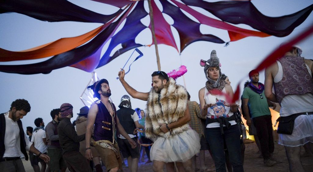 Costumed party-goers dancing during the second annual Midburn festival, the Israeli version of Burning Man on May 24, 2015. (Photo credit: Ben Kelmer/Flash90)