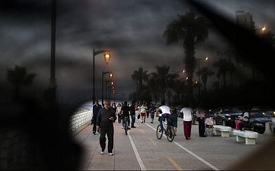 Lebanese citizens walking on the Corniche, or waterfront promenade in Beirut, Lebanon. This photo was shot through the lowered veil of a niqab, which is worn by some conservative Muslim women. The cloth allows women to follow a strict interpretation of their religious beliefs by preventing others from seeing their faces. (AP Photo/Hassan Ammar)