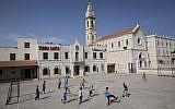 Arab Israeli Christian schoolchildren play soccer at the Terra Sancta School in the mixed Jewish-Arab city of Ramle, May 26, 2015. (AP/Oded Balilty)
